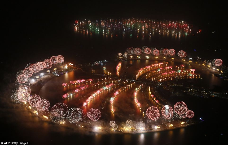Fireworks explode over Palm Jumeirah in Dubai. The country kicked off New Year with a dazzling bid for a new world record to cap those the Gulf city state already holds for its mammoth property developments