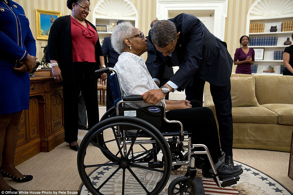 May 24, 2013. Thelma Maxine Pippen McNair, mother of Denise McNair, whispers to the President after he signed H.R. 360, which provided for the presentation of a congressional gold medal to commemorate the lives of the four young African American victims of the bombing of the Sixteenth Street Baptist Church in Birmingham, Alabama, in September 1963. McNair's daughter was one of the victims