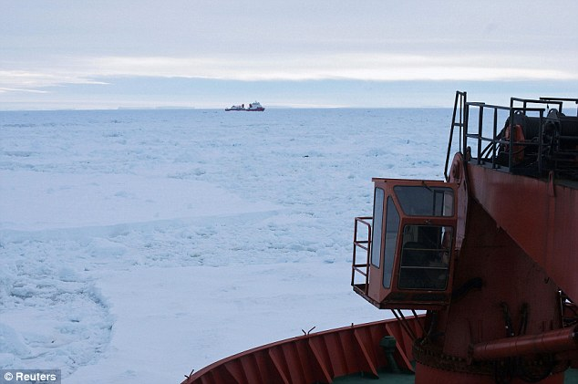 Complex operation: The Xue Long (Snow Dragon) Chinese icebreaker, as seen from Australia's Antarctic supply ship the Aurora Australis, sits in an ice pack unable to make its way back to open water