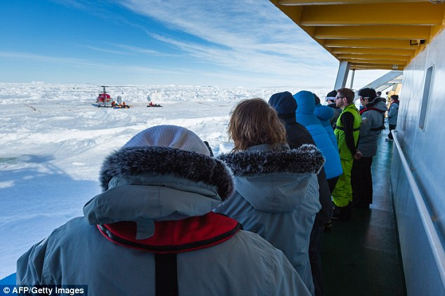 Sea ice was preventing the barge from reaching the Chinese icebreaker, the Snow Dragon, so the passengers are instead being taken to an nice floe next to an Australian vessel which will eventually take them to Tasmania