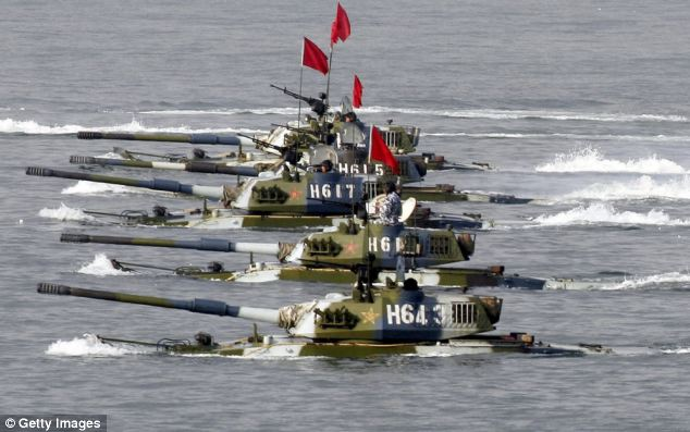 Amphibious tanks of the Chinese People's Liberation Army move to land a beach