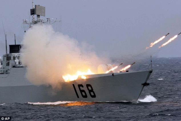 A Chinese naval vessel launches anti-submarine missiles in an offshore blockade exercise