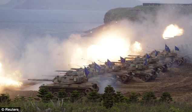 M60A3 tanks fire off shells during the annual Han Kuang military exercise in Penghu, west of Taiwan