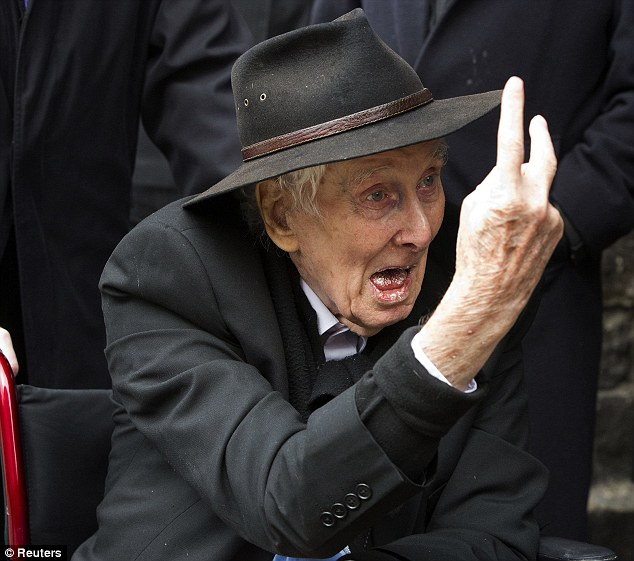 Defiant to the last: Thief Ronnie Biggs swears at photographers at the funeral of fellow Great Train Robber Bruce Reynolds last year