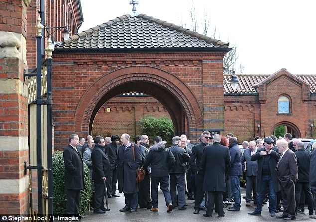 Grief: The crowd of mourners at Golders Green crematorium in north London this afternoon