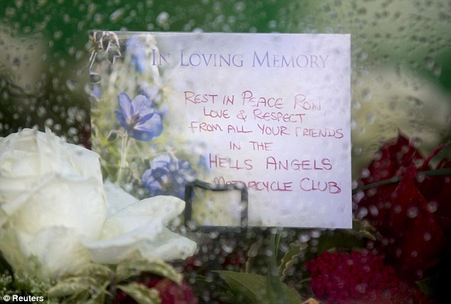 'From all your friends': A bouquet of flowers from the Hells Angels bikers with a note which says 'rest in peace Ron, love and respect'