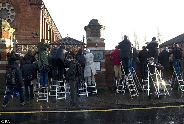 Press pack: Photographers compete for space outside Golders Green Crematorium