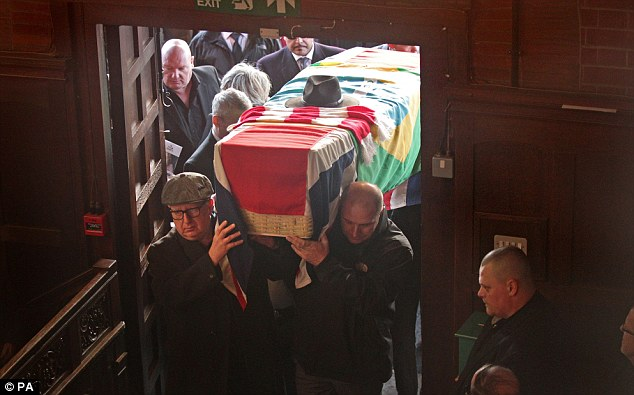 Respects: Ronnie Biggs' coffin is carried into the crematorium this afternoon