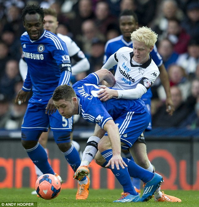 Too close for comfort: Chelsea's Gary Cahill is put under pressure from Will Hughes