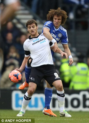 Rough treatment: Derby's Chris Martin (front) is challenged by Chelsea's David Luiz for the ball