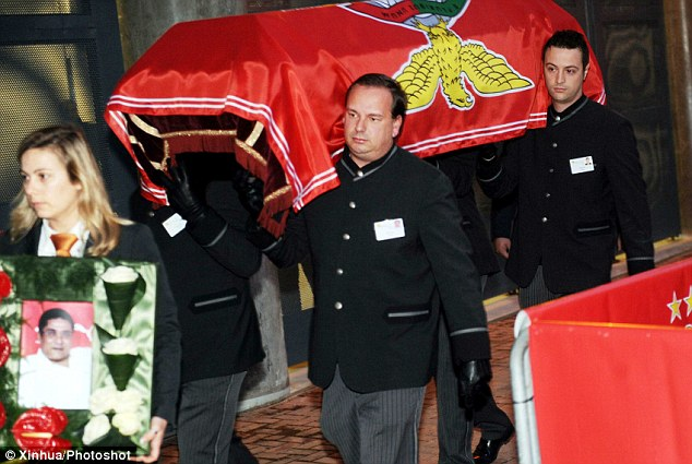 Final farewell: The body of Eusebio is brought into the Estadio da Luz in a coffin for fans to pay their respcts