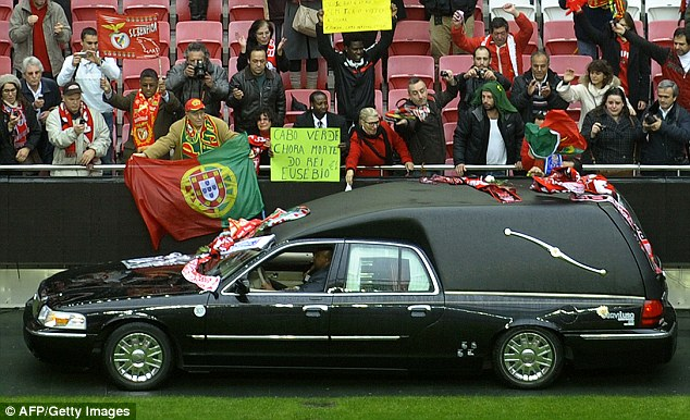 Procession: Fans gather in the Estadio da Luz to pay their respects for one of Benfica's true greats