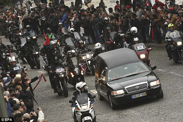 Respects: The funeral procession passed through the Lisbon streets with thousands there to watch