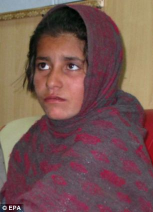 Terrifying: A young Afghan girl has been detained wearing a suicide vest in southern Afghanistan