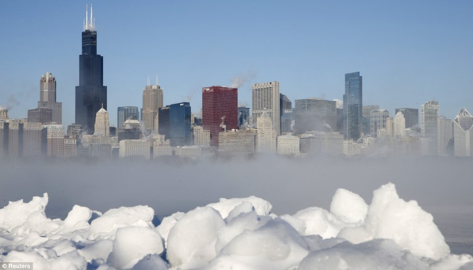 The Chicago Skyline sits as a backdrop as fog drifts across Monroe Harbor with temperatures well below zero and wind chills expected to reach 40 to 50 below as the whirlpool of frigid, dense air known as the 'Polar Vortex' descended onto much of the U.S. on Monday