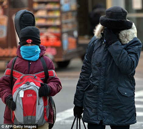 A woman and young boy head to school in Manhattan on Tuesday morning