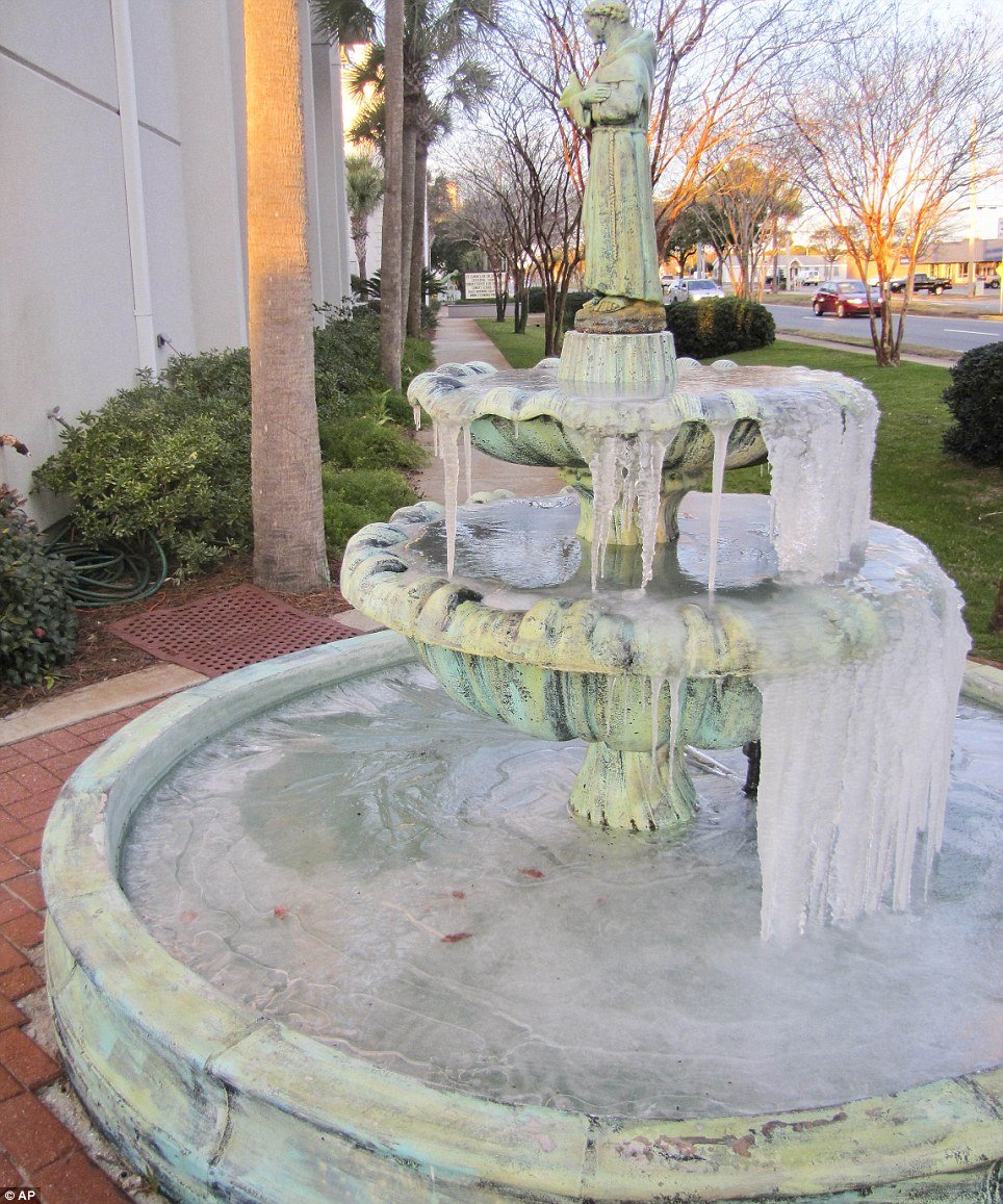 St. Simon's on the Sound Episcopal Church's fountains were frozen over Tuesday just after sunrise in Fort Walton Beach, Florida where locals are unaccustomed to such temperatures