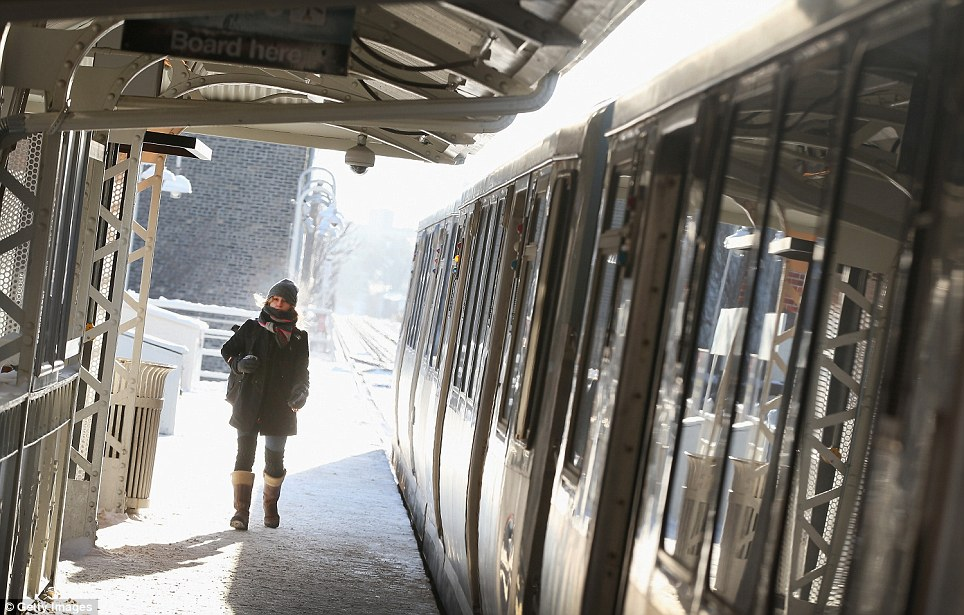 A passenger catches the train today in Chicago, Illinois. Many trains were delayed on the system because doors on the trains kept freezing open