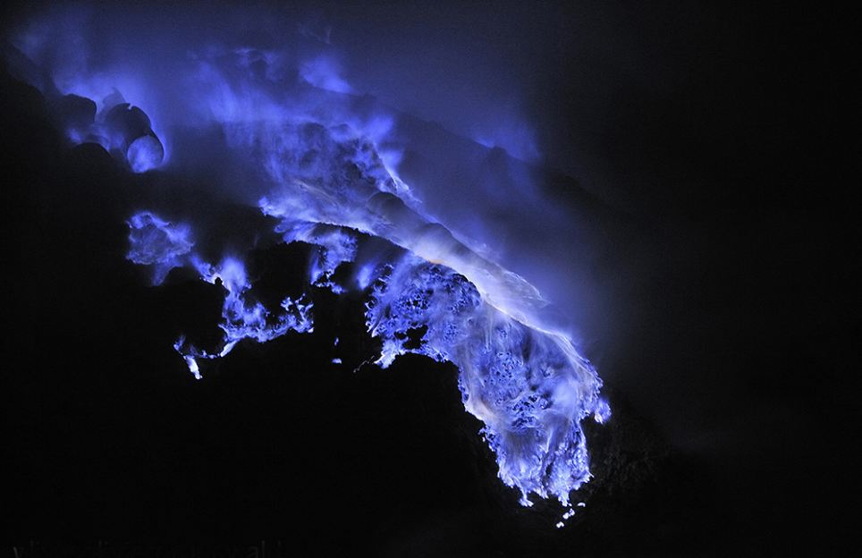 The molten chemical comes from the sides of the Kawah Ijen volcano in Indonesia and is directed through pipes by miners to collection points in a nearby crater