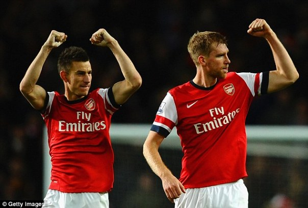 Solid as a rock: Per Mertesacker (right) and Laurent Koscielny (left) have not lost a league match for almost two years when they have both started and finished a game for title-challenging Arsenal