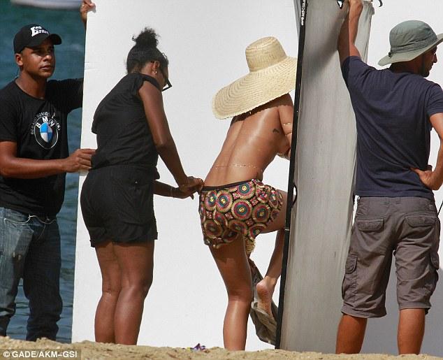 Just a hint: A wardrobe assistant arranges Rihanna's shorts