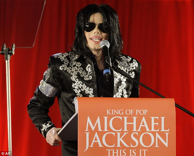Done: The case between Michael Jackson's estate and Lloyd's Of London has been settled, lawyers for both parties announced on Wednesday; here the singer is seen in 2009 promoting his London tour