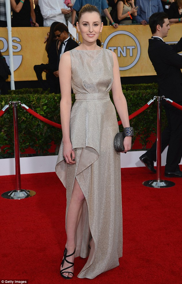 Golden girl: Laura Carmichael looked radiant in a glistening golden gown
