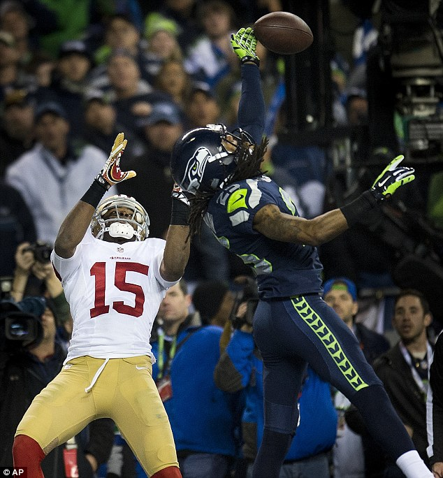 Seattle Seahawks cornerback Richard Sherman (25) hits the ball away from San Francisco 49ers wide receiver Michael Crabtree (15) in a winning play