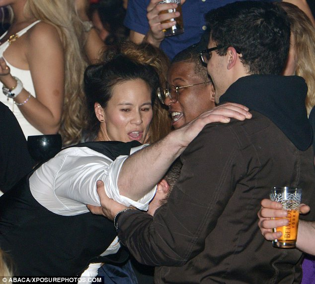 Worse for wear: Robin clutched on to some clubgoers for support as he took a break from dancing with the mystery lady