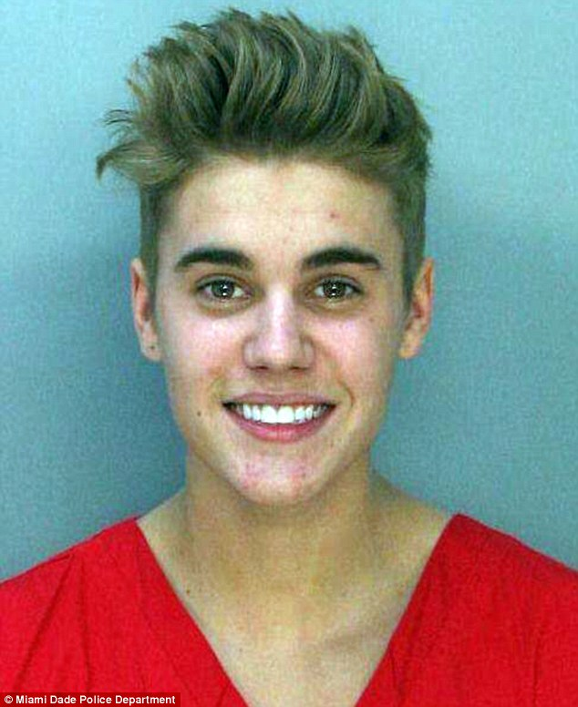 Booked: Justin was smiling for his mug shot taken in county jail