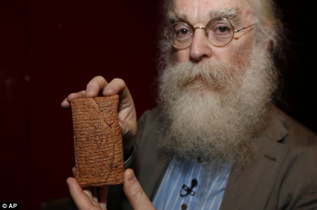 Irving Finkel, curator in charge of cuneiform clay tablets at the British Museum, poses with the 4000 year old clay tablet containing the story of the Ark and the flood, that claims the Ark was actually round