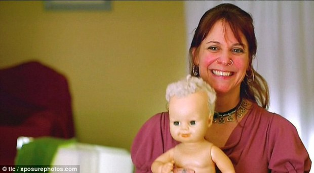 Doll lover: Cat, 48, from Seattle, Washington, has been addicted to this 18-inch plastic doll called Volo for the past eight years, since an ex-boyfriend bought it for her