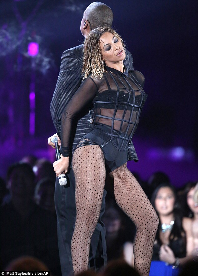 Bump and grind: Beyoncé was joined by husband Jay Z on stage, and performed some seductive dancing up against her spouse