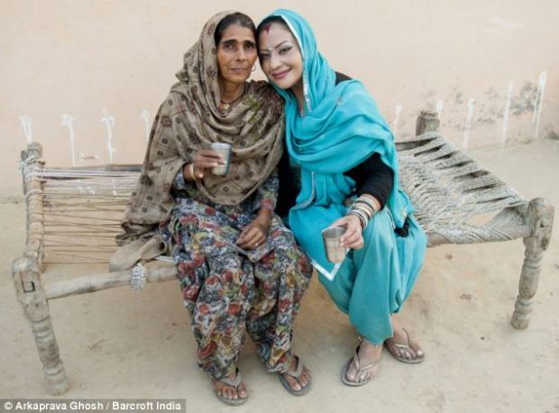 Family: Adriana Peral and her mother-in-law Bimla Devi share a moment together at the front yard of their house in a village in Panipat, India