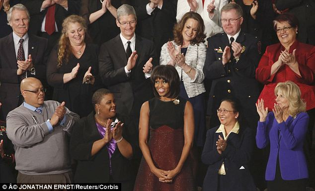 Honoring Americans: Mrs Obama is surrounded by people that the administration wants to highlight as heroes and leaders and she is seated with them at the annual State of the Union address (seen here in 2013)