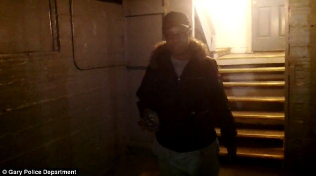 Portal to Hell: Rosa Campbell, Latoya's mother, gives police a tour of the basement that was said to be the base of the demons that possessed the family