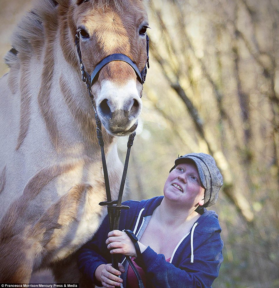 Close: Miss McKenna, 23, pictured with her 19-year-old mare near her home in Scotland