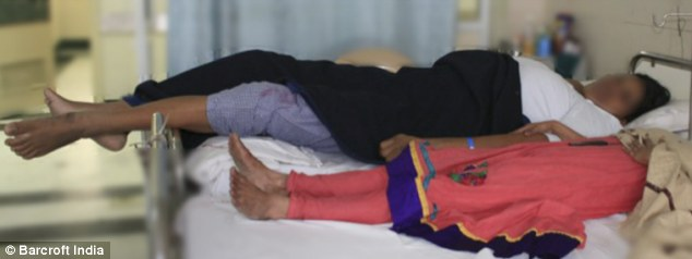 Hard to fit: Siddiqa Parveen, seen recovering after the successful operation which removed her tumour