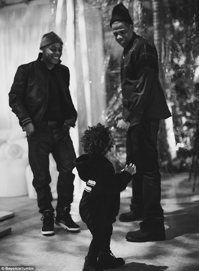 Baby steps: It seems Blue has already found her feet mingling backstage with her parents and their pals on tour