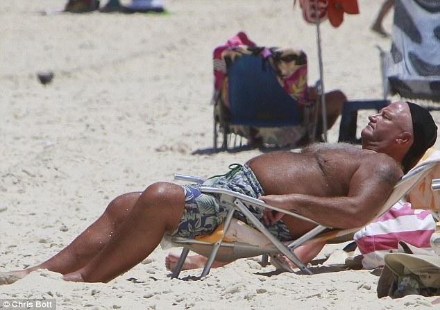 Frying down in Rio: Union baron Bob Crow soaks up the sun on Copacabana beach