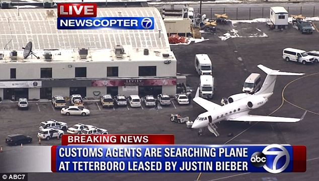 Being held: The private plane that allegedly brought Bieber, his father, and their entourage to New Jersey's Teterboro airport was searched by authorities after landing