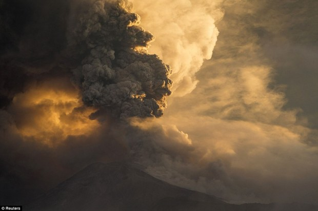 At least 16 people have been killed by a violent volcanic eruption on the island of Sumatra in Indonesia which sent ash spewing several miles into the air