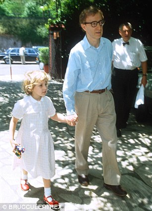 Unsettling allegations: Farrow, seen here with Allen in Italy in 1991, wrote how the director would stick his thumb in her mouth, force her to get in bed with him and place his head in her naked lap