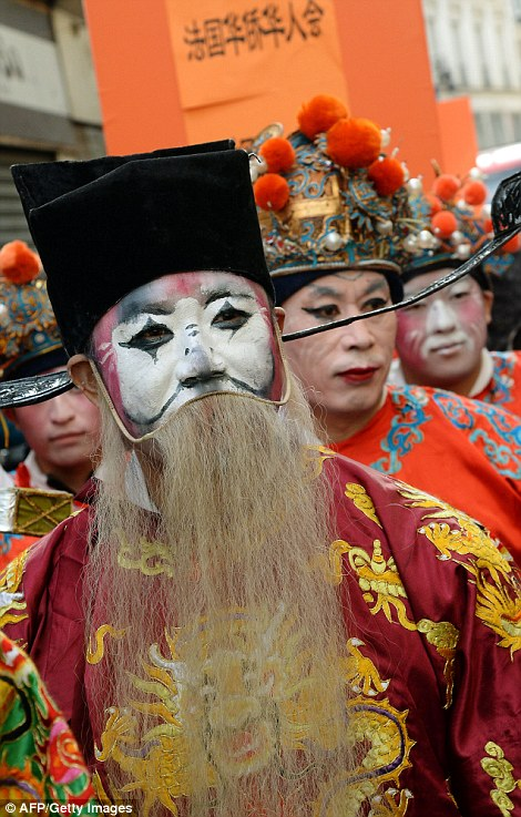 People in costumes take part in a parade to celebrate the Chinese New Year in Paris