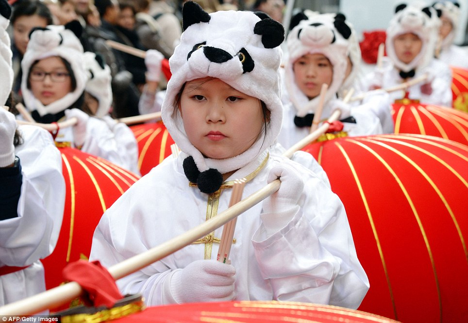 Children in panda costumes take part in the new year celebrations in Paris