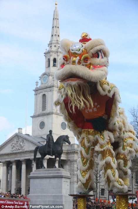 Crowds flock: Thousands of Londoners head into the city for Chinese New Year celebrations in Trafalgar Square