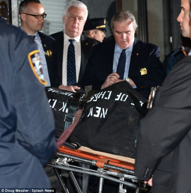 Tragic: The body of Philip Seymour Hoffman was removed from his apartment building just before 7 p.m. Sunday after he died on Sunday after being discovered earlier on in the day by his friend, David Bar Katz