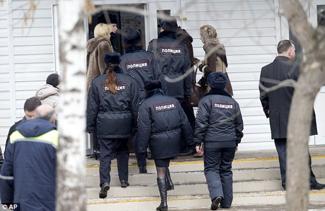 Police officers enter a Moscow school with a teacher where two people were killed by a student this morning