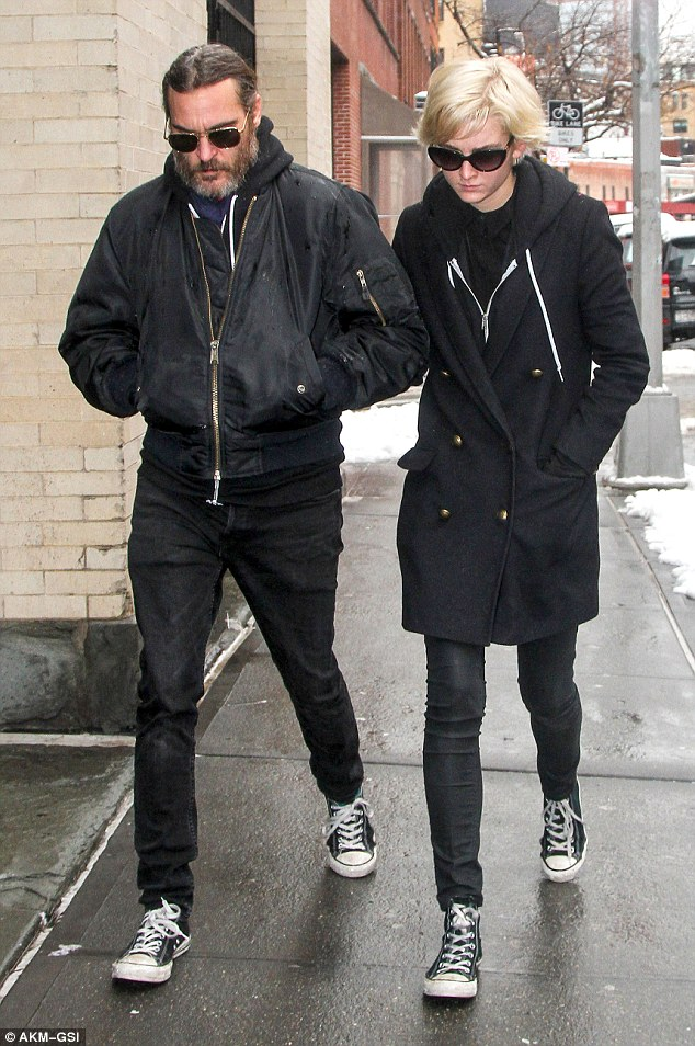More support: Joaquin Phoenix and his girlfriend Allie Teilz head back to Mimi O'Donnell's house Wednesday to pay their respects after the death of their good friend Philip Seymour Hoffman