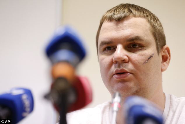 Bulatov talks to the media in a hospital in Vilnius, Lithuania. He fled the Ukraine for fear of being prosecuted
